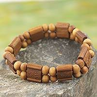 Wood stretch bracelet, 'Brown Radiance' - Artisan Crafted Sese Wood Stretch Bracelet from Ghana