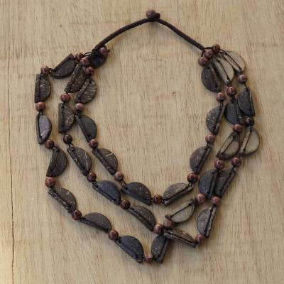 Coconut shell beaded necklace, 'Coconut Strands' - Handmade Coconut Shell and Sese Wood Beaded Necklace