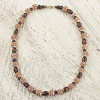 Wood and terracotta beaded necklace, 'Oheneyire' - Hand Crafted Sese Wood and Terracotta Beaded Necklace