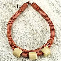 Leather and bone torsade necklace, 'Yembo Orange' - Bone Squares on Leather Artisan Crafted Torsade Necklace