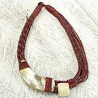 Leather and horn torsade necklace, 'Sougri Paprika' - Handmade Red Leather Necklace with Horn and Bone Pendants