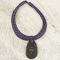 Ebony wood pendant necklace, 'Zacksongo in Purple' - Ebony Wood Pendant Necklace with Purple Leather Cord