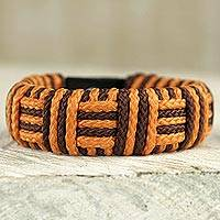 Cord bracelet, 'Brown and Orange Kente Power' - Brown and Orange Cord Striped Bracelet Handmade in Ghana