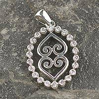 Sterling silver pendant, 'The Weight of the Earth' - Sterling Silver Adinkra Cubic Zirconia Pendant from Ghana