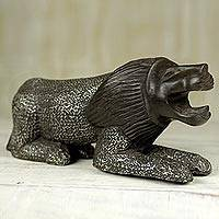 Wood figurine, 'Brave Lion' - Aluminum Coated Wooden Lion Crouched in Kneeling Pose