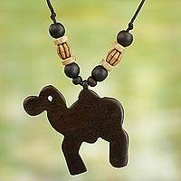 Wood pendant necklace, 'Whimsical Camel' - Artisan Crafted Camel Wood Pendant Necklace from Ghana