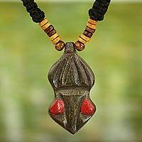 Wood pendant necklace, 'Gyau Atiko' - Hand Carved Wooden Pendant and Cord Necklace from Ghana