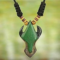 Wood pendant necklace, 'African Horns' - Adjustable Sese Wood Pendant Necklace in Green from Ghana