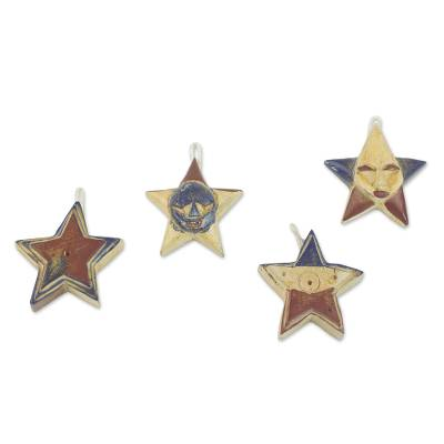 Wood ornaments, 'Nsruma Pride' (set of 4) - Four Sese Wood Star Ornaments in Red Blue and Beige