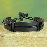 Men's leather wristband bracelet, 'Enduring Strength in Black' - Men's Black Leather Wristband Bracelet from Ghana