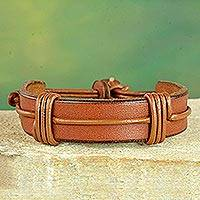 Men's leather wristband bracelet, 'Enduring Strength in Tan' - Men's Brown Leather Wristband Bracelet from Ghana