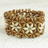 Wood beaded stretch bracelet, 'African Stars in Tan' - Sese Wood Beaded Bracelet in Tan and Cream from Ghana