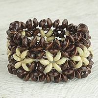 Wood beaded stretch bracelet, 'African Stars in Dark Brown' - Sese Wood Beaded Bracelet in Dark Brown and Cream from Ghana