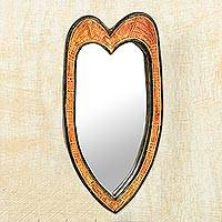 Wood wall mirror, 'Contours of Love' - Handcrafted Wood Heart-Shaped Wall Mirror from Ghana