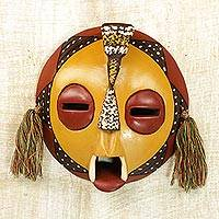 African wood mask, 'Calm One' - Handcrafted Yellow Sese Wood Wall Mask from Ghana