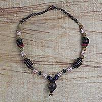 Wood beaded pendant necklace, 'Charming Lover' - Sese Wood and Ceramic Beaded Necklace from Ghana