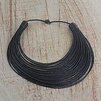 Leather statement necklace, 'Bayala' - Handmade Black Leather Strand Statement Necklace from Ghana