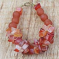 Agate and recycled glass beaded bracelet, 'Coral Kiss' - Handmade Coral Red Agate and Recycled Glass Beaded Bracelet