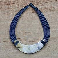 Horn pendant necklace, 'Sida' - Crescent-Shaped Horn Pendant Necklace with Blue Leather Cord