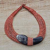 Horn pendant necklace, 'Tuumsongo' - Boomerang Horn Pendant Orange Leather Cord Necklace