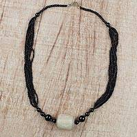 Horn and glass beaded pendant necklace, 'Anigye' - Multi-Layered Black Beaded Glass Horn Pendant Necklace