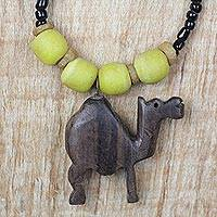 Ebony wood and recycled glass beaded pendant necklace, 'On Dry Land' - Ebony Wood and Glass Camel Pendant Necklace from Ghana