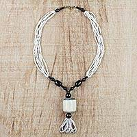 Horn and recycled glass beaded pendant necklace, 'Mother's Warmth' - White and Black Beaded Glass Horn Pendant Necklace