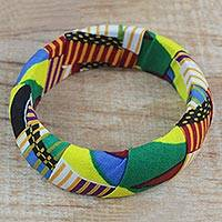 Wood and cotton bangle bracelet, 'Great Wisdom' - Wrapped Multi-Colored Cotton Sese Wood Bangle Bracelet