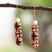 Coconut shell dangle earrings, 'Natural Cross' (Ghana)