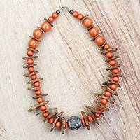 Wood and coconut shell beaded necklace, 'Sunny Energy' - Wood Coconut Shell and Ceramic Beaded Necklace in Orange