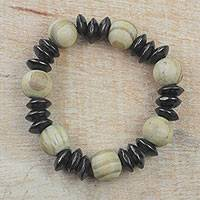 Wood beaded stretch bracelet, 'Charming Mother' - Brown and Black Sese Wood Beaded Stretch Bracelet from Ghana