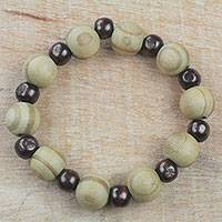 Wood beaded stretch bracelet, 'Circle of Beauty' - Handcrafted Sese Wood Beaded Stretch Bracelet from Ghana