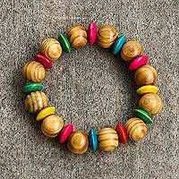 Wood beaded stretch bracelet, 'Eye of the Parrot' - Multicolored Sese Wood Beaded Stretch Bracelet from Ghana
