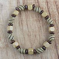 Wood beaded stretch bracelet, 'Unending Love' - Handcrafted Sese Wood Recycled Beaded Stretch Bracelet