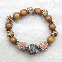 Ceramic and wood beaded stretch bracelet, 'Nostalgic Beauty' - Handcrafted Ceramic and Wood Beaded Bracelet from Ghana
