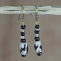 Batik wood and bone dangle earrings, 'All Is Well' - Black and White Recycled Sese Wood and Bone Dangle Earrings