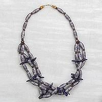 Recycled plastic and wood beaded necklace, 'God-Sent in Purple' - Floral Recycled Plastic and Purple Coconut Shell Necklace