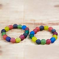 Recycled glass beaded stretch bracelets, 'Festive Sensation' (pair) - Pair of Multi-Colored Recycled Glass Beaded Bracelets