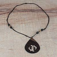 Wood pendant necklace, 'Gye Nyame Drop' - Sese Wood Gye Nyame Pendant Necklace from Ghana