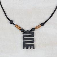 Wood pendant necklace, 'Beautiful Nkyinkyim' - Adinkra Nkyinkyim Sese Wood Pendant Necklace from Ghana
