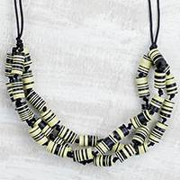 Recycled plastic beaded necklace, 'Live with Praise' - Recycled Plastic Disc Black and Yellow Statement Necklace