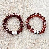 Recycled glass bead stretch bracelets, 'Fiery Duo' (pair) - Dark Red Orange Recycled Bead Stretch Bracelets (Pair)