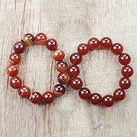 Recycled glass beaded stretch bracelets, 'Hill and Valleys' (pair) - Cinnamon Hills and Valleys Recycled Glass Beaded Bracelets