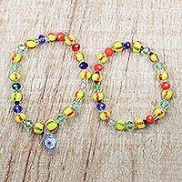 Recycled glass beaded stretch bracelets, 'Greater Grace' (pair) - Multi-Colored Recycled Glass Beaded Pair of Bracelets