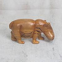 Wood figurine, 'Sauntering Hippo' - Handcrafted Walking Hippo Wood Figurine from Ghana