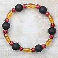 Recycled glass beaded stretch bracelet, 'Unending Affection' - Black Red and Honey Brown Recycled Glass Stretch Bracelet