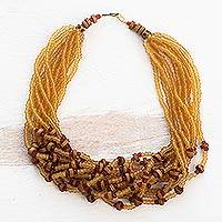 Recycled glass and wood torsade necklace, 'Sunshine Blessings' - Yellow Recycled Glass Beaded and Sese Wood Torsade Necklace