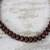 Recycled plastic beaded necklace, 'Peaceful Calm' - Eco Friendly Recycled Plastic Dark Brown Beaded Necklace (image 2b) thumbail