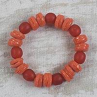 Recycled glass beaded stretch bracelet, 'Tropicana Color' - Handcrafted Orange Recycled Glass Beaded Stretch Bracelet