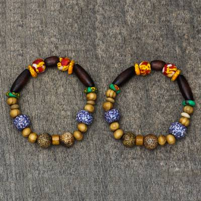 Wood and recycled glass beaded stretch bracelet, 'Revealing Beauty' - Wood and Recycled Glass Beaded Stretch Bracelet from Ghana